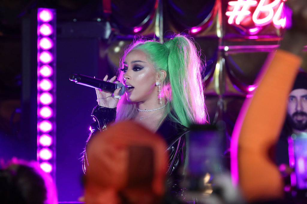 Doja Cat performing at a show in January 2020