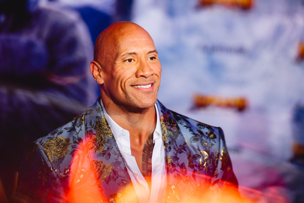 Dwayne 'The Rock' Johnson smiling, turned to the right
