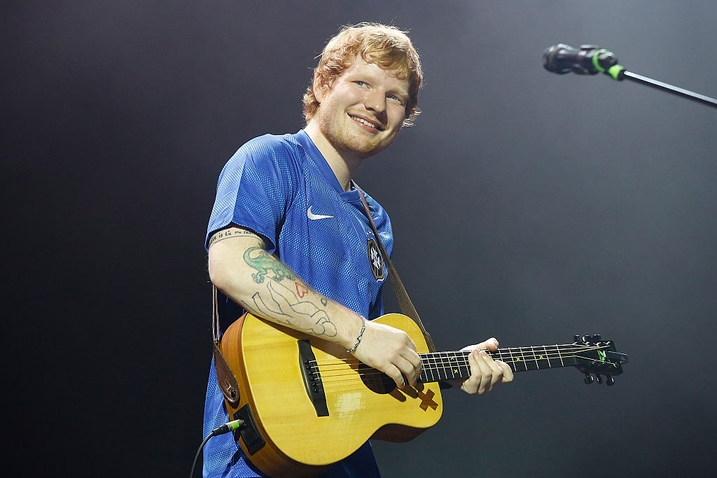 Ed Sheeran smiling during a concert