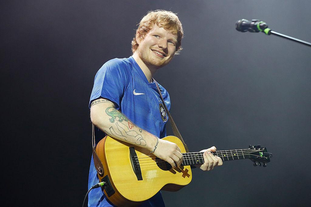 Ed Sheeran smiling during a concert