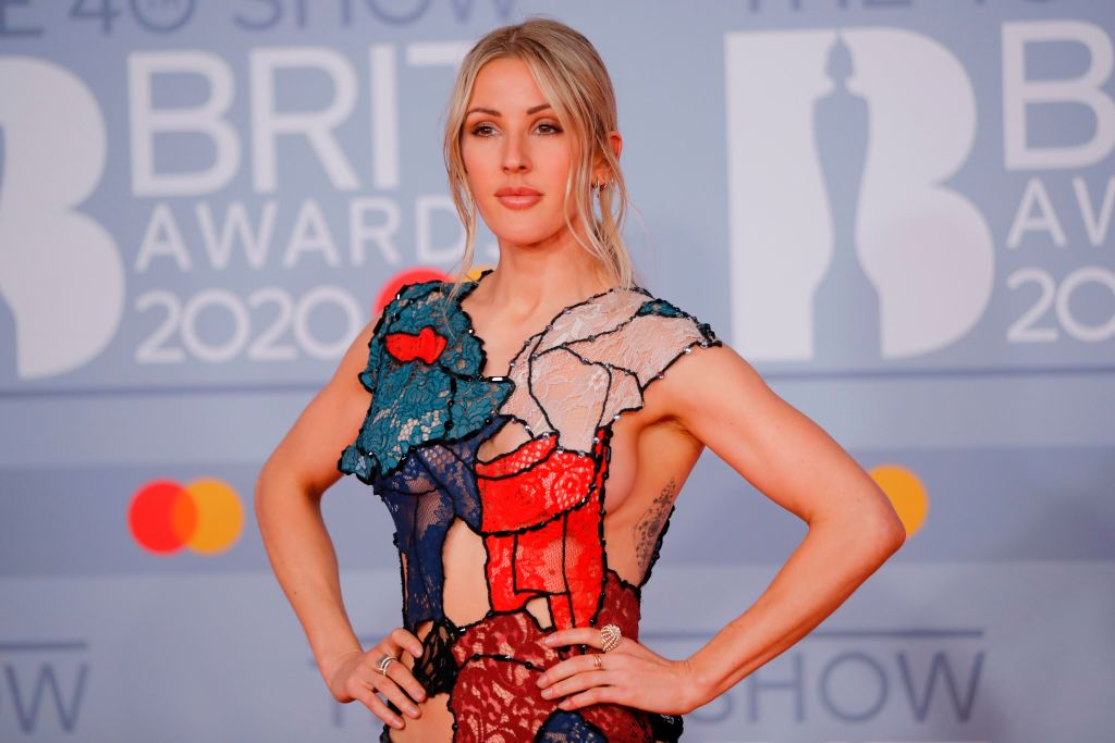 Ellie Goulding poses on the red carpet on arrival for the BRIT Awards 2020 in London