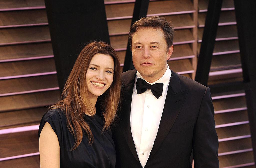 Actress Talulah Riley (L) and Elon Musk arrive to the 2014 Vanity Fair Oscar Party