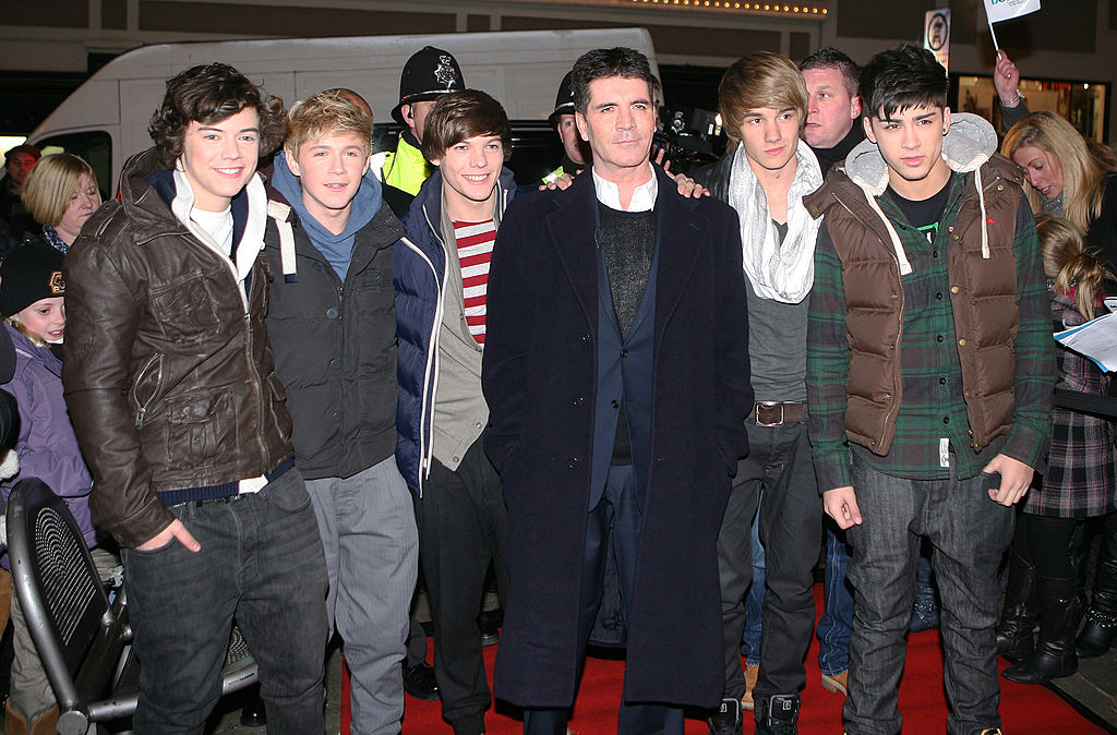16-year-old Harry Styles with the newly formed One Direction and Simon Cowell in 2010