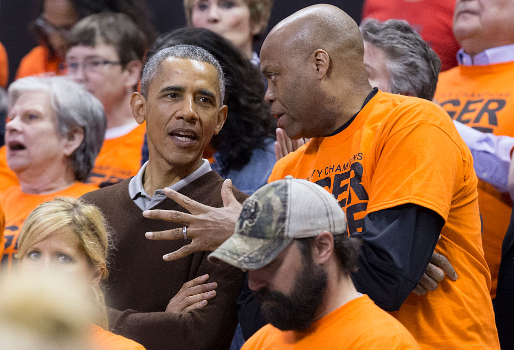 Former U.S. president Barack Obama and his brother-in-law Craig Robinson