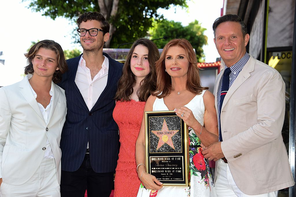 Roma Downey at her 2016 Hollywood Walk of Fame ceremony with from left, her stepsons Cameron Burnett and James Burnett, her daughter Reilly Marie Anspaugh, and Downey's husband Mark Burnett