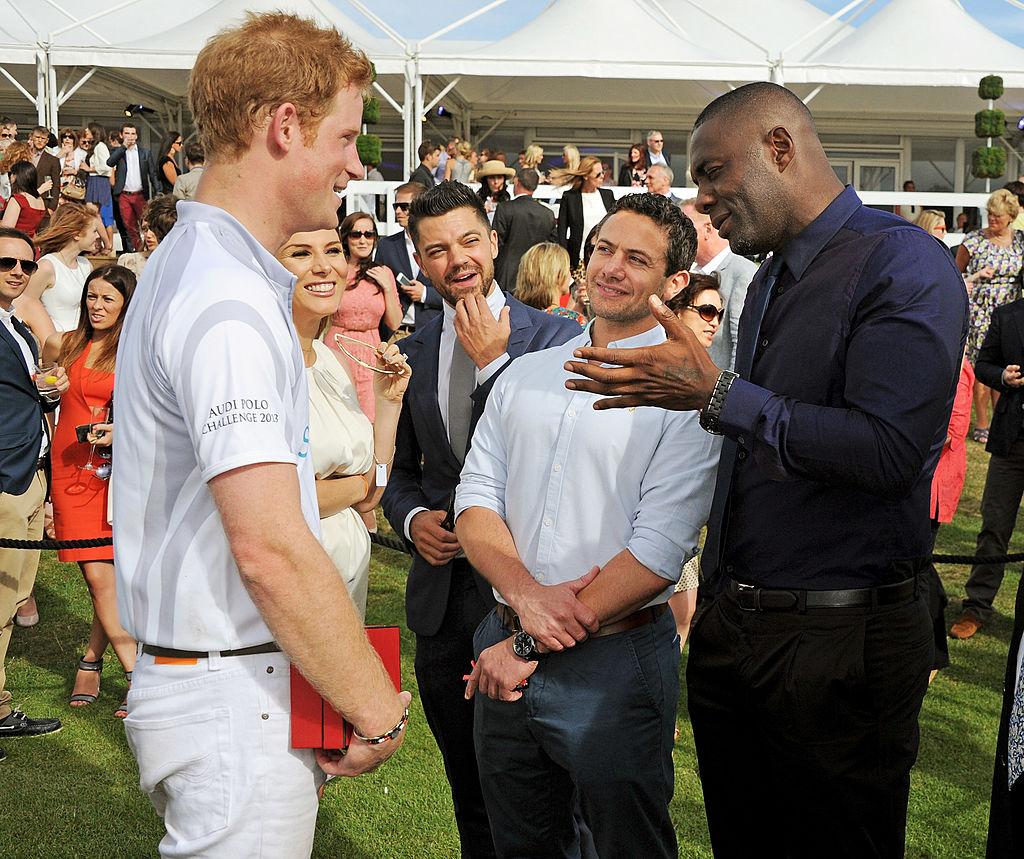 Idris Elba talking to Prince Harry