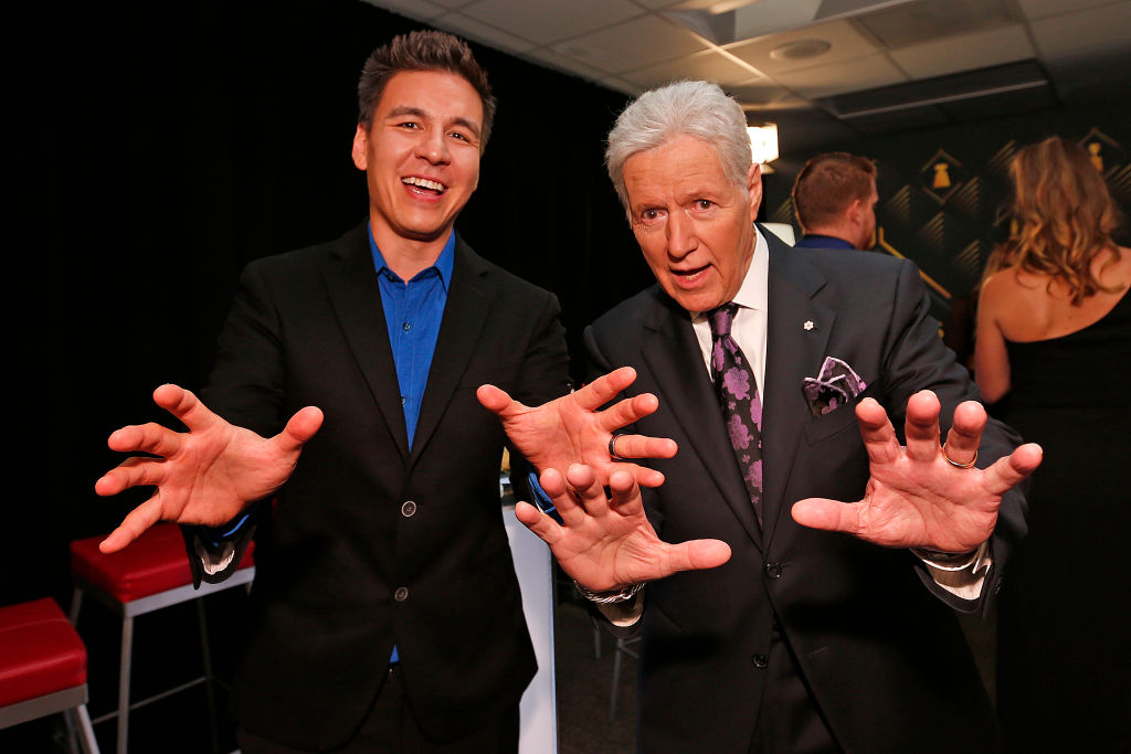 """Jeopardy!"" host Alex Trebek poses with 'Jeopardy!' champion James Holzhauer backstage at the 2019 NHL Awards."