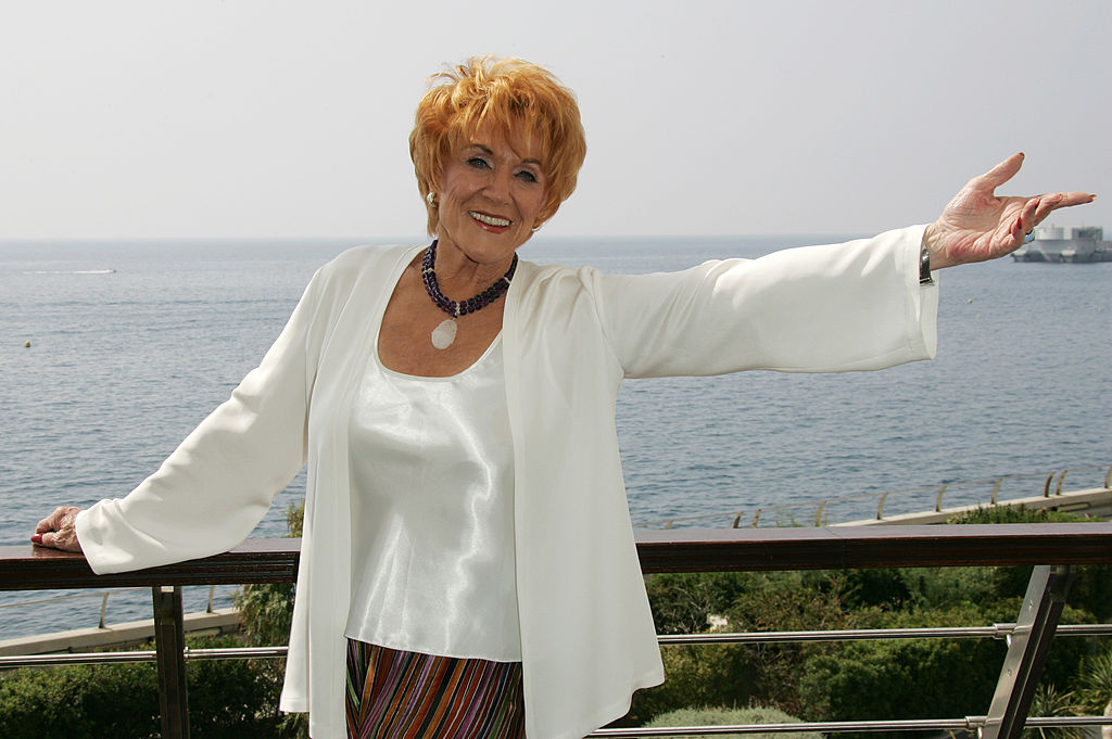 Jeanne Cooper smiling in front of a landscape