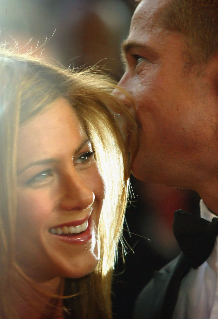 "Brad Pitt and Jennifer Aniston attend the World Premiere of epic movie ""Troy"" at Le Palais de Festival on May 13, 2004"