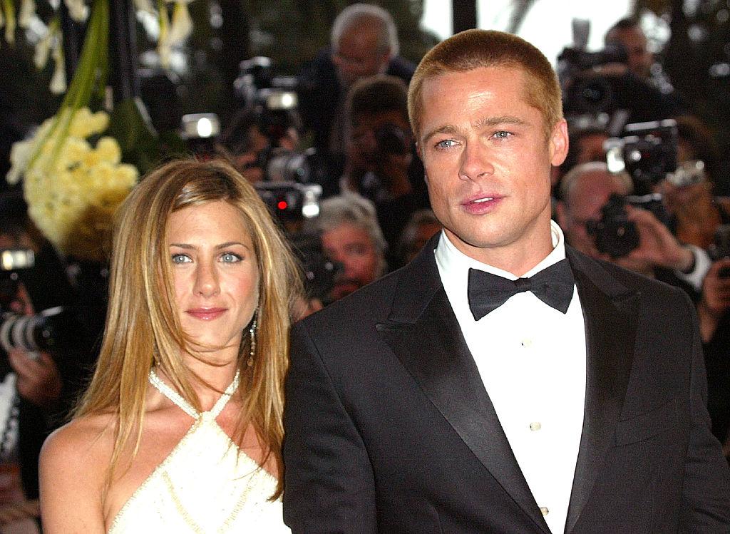 Jennifer Aniston and Brad Pitt smiling