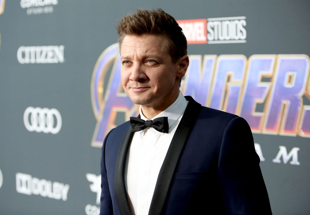 Jeremy Renner smiling, looking off camera