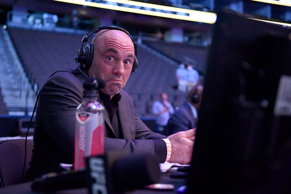 Joe Rogan looks at the camera during a UFC event