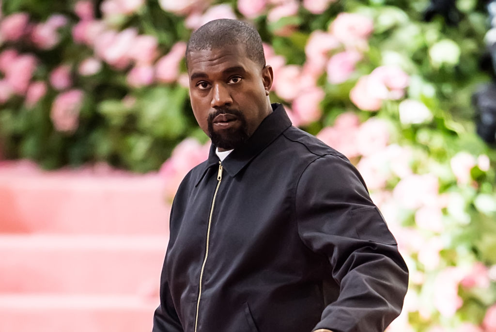Kanye West not smiling, looking at the camera
