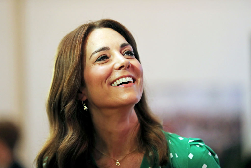 Kate Middleton smiling, looking up and to the right