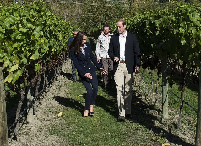 Kate Middleton and Prince William walking through a vineyard