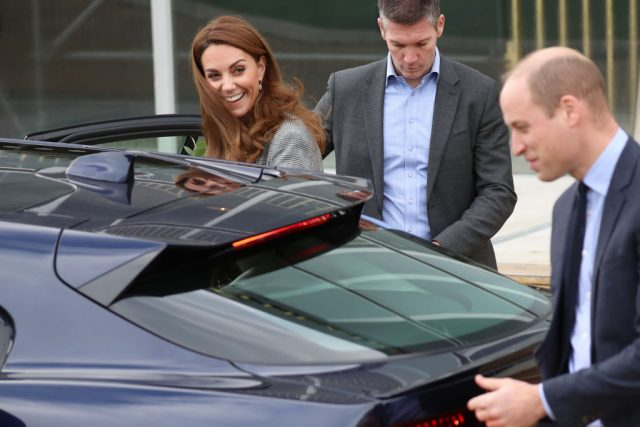 Kate Middleton smiles as she and Prince William get in a car