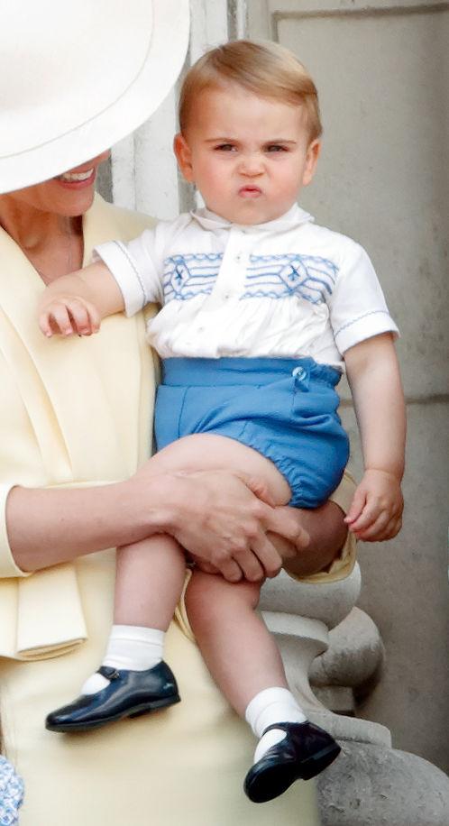 Kate Middleton holding Prince Louis