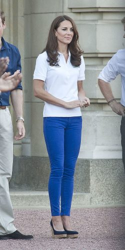 Kate Middleton waits for the Olympic Torch