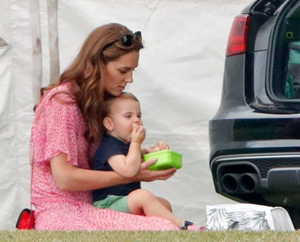 Kate Middleton sits with Prince Louis on her lap at a polo match, 2019