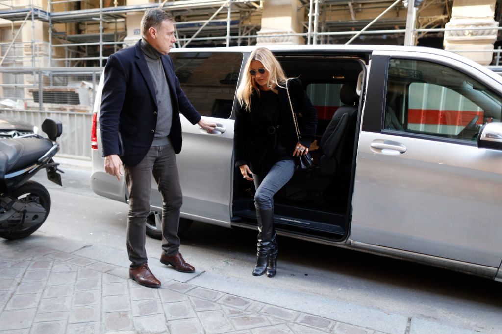 Kate Moss getting out of a car with a driver