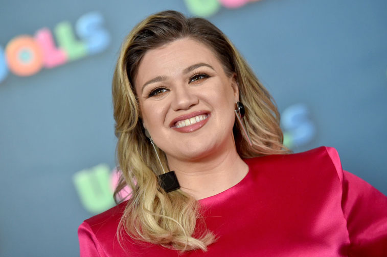 Kelly Clarkson smiling in red outfit