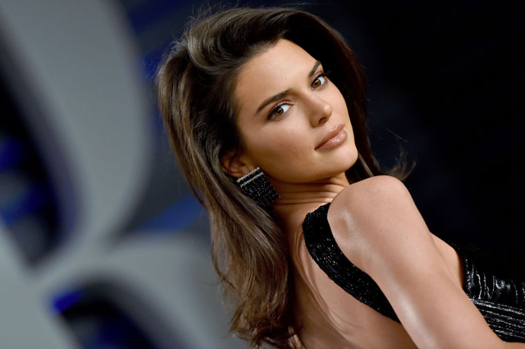 Kendall Jenner looking past her shoulder on the red carpet