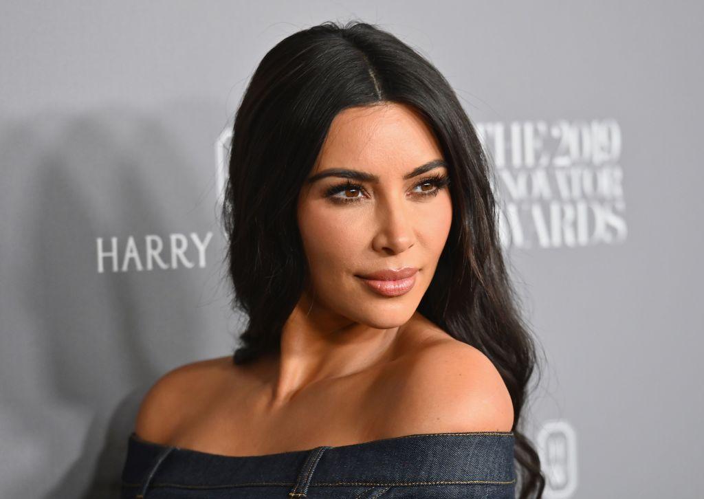 Kim Kardashian West smiling looking to the side