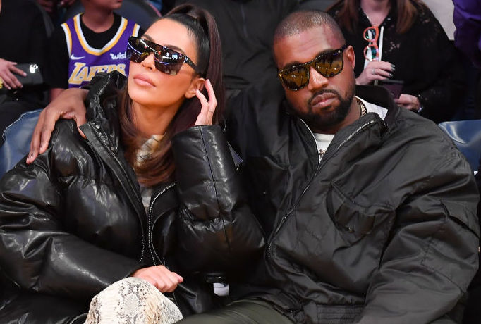 Kim Kardashian West and Kanye West at a basketball game in January 2020