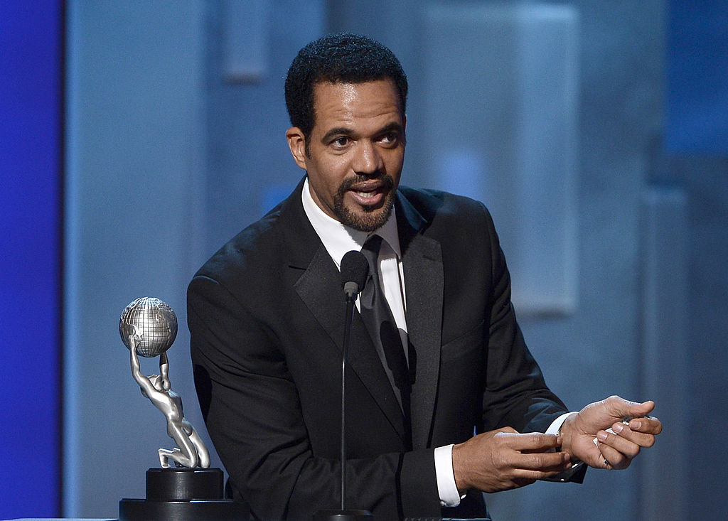 Kristoff St. John at a podium speaking into a microphone