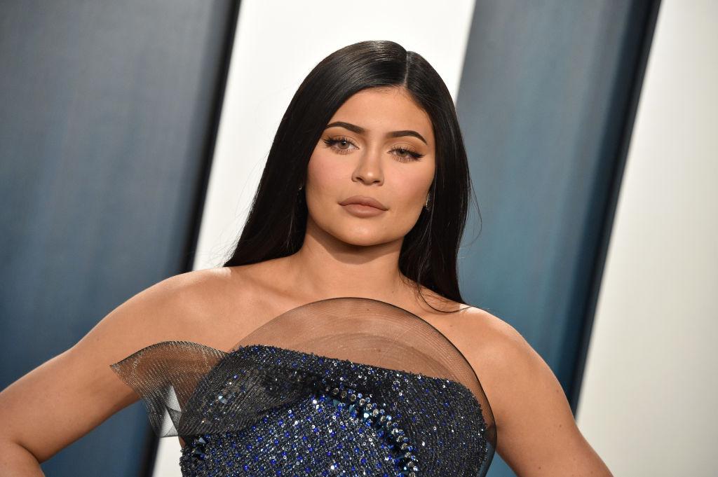 Kylie Jenner smiling, looking downward