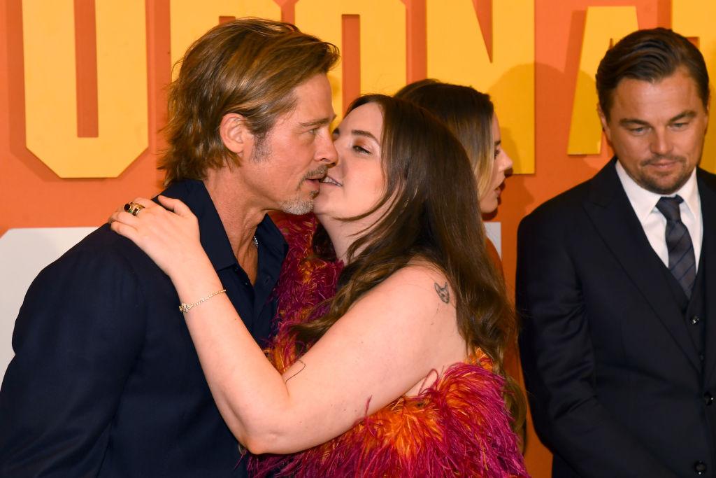 Lena Dunham and Brad Pitt kissing on the red carpet