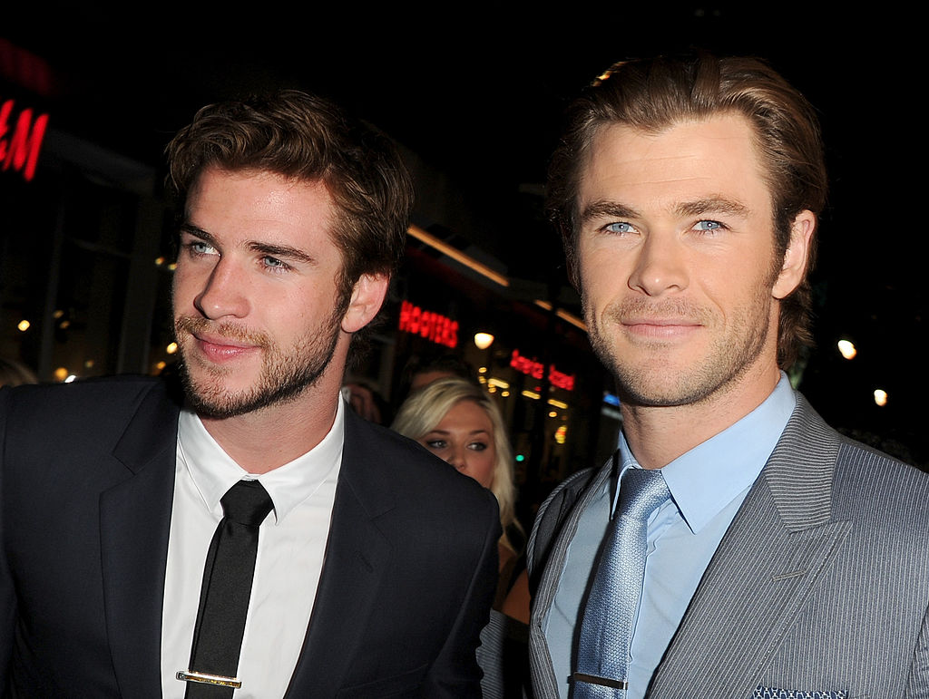 Liam Hemsworth (L) and Chris Hemsworth arrive at the premiere of Marvel's 'Thor: The Dark World'