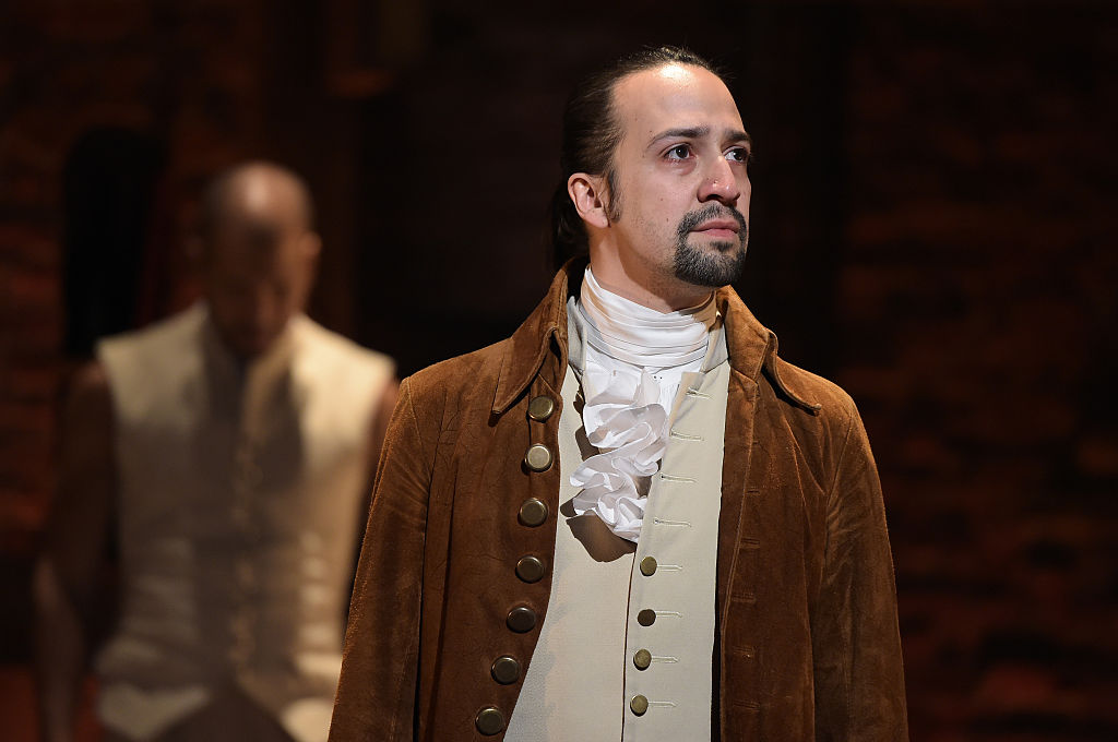 """Actor, composer Lin-Manuel Miranda is seen on stage during """"Hamilton"""" GRAMMY performance for The 58th GRAMMY Awards at Richard Rodgers Theater on February 15, 2016 in New York City"""