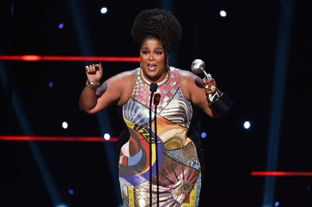 Lizzo accepts Entertainer of the Year award onstage during the 51st NAACP Image Awards