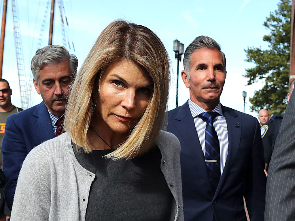 Lori Loughlin and her husband Mossimo Giannulli, right, leave the John Joseph Moakley United States Courthouse