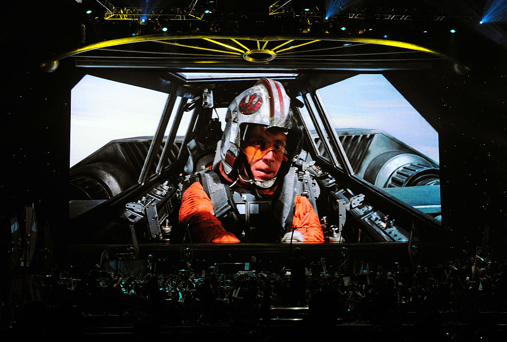 Mark Hamill as Luke Skywalker in 'Star Wars Episode V: The Empire Strikes Back' on screen while musicians perform during Star Wars: In Concert at the Orleans Arena in May 2010