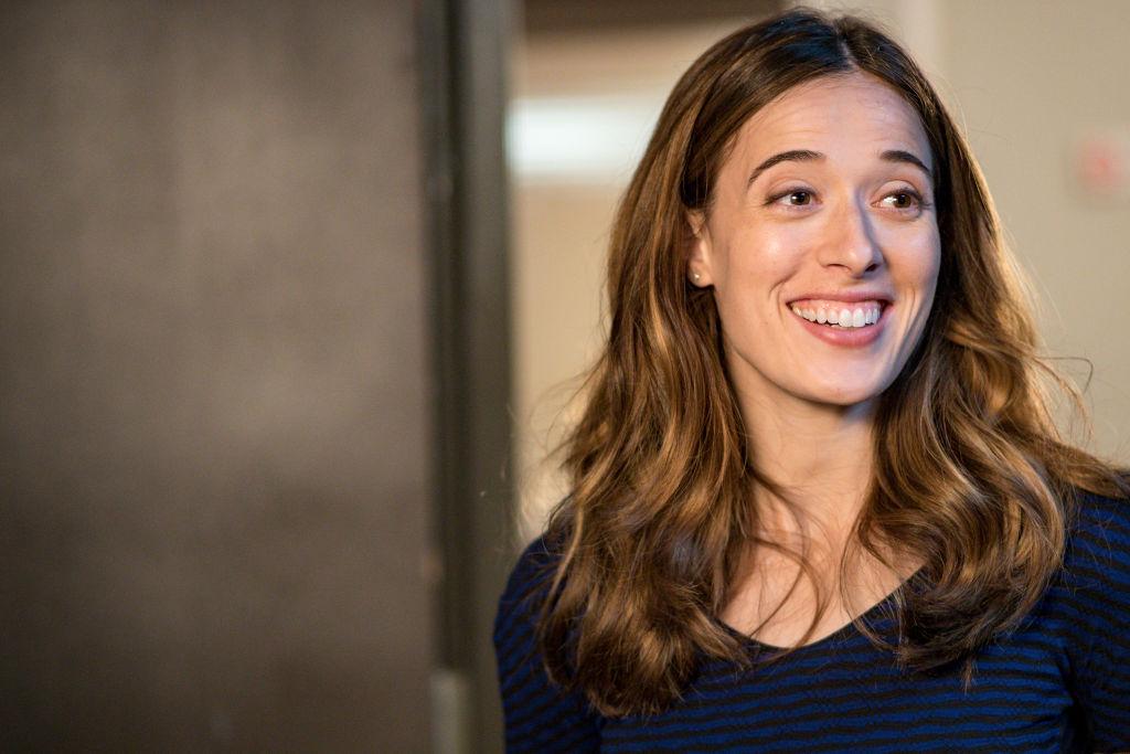 Marina Squerciati as Kim Burgess smiling, looking off camera