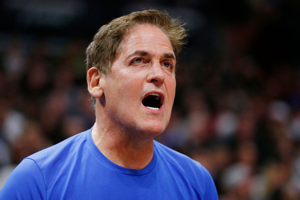 Owner Mark Cuban of the Dallas Mavericks reacts against the Miami Heat d