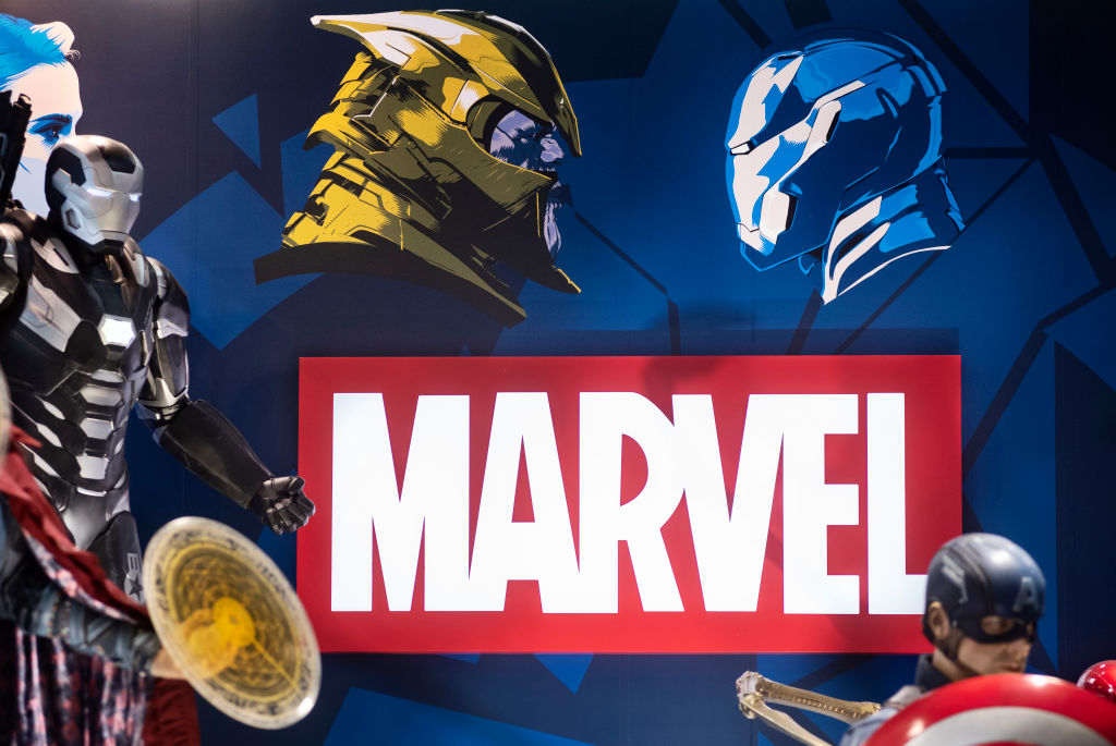 Marvel logo with costume models in front and to the sides