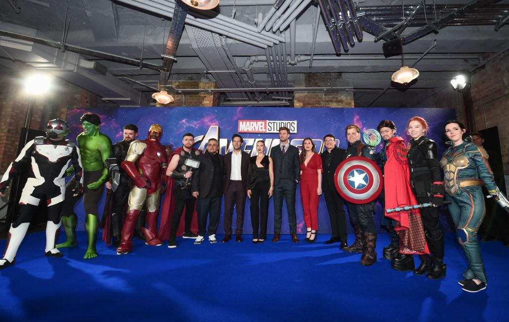 Joe Russo, Paul Rudd, Scarlett Johansson, Chris Hemsworth, Trinh Tran and Anthony Russo pose with Marvel characters