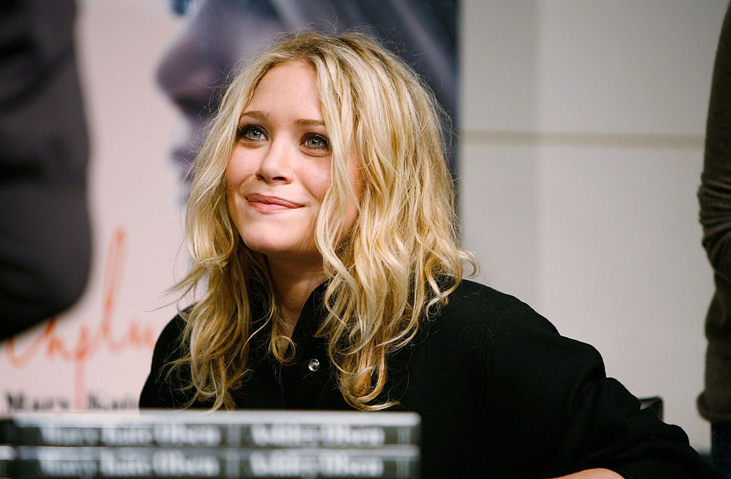Mary-Kate Olsen smiling, looking away from the camera