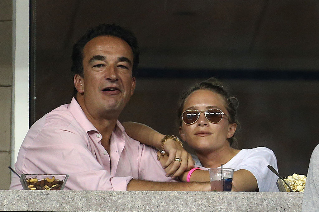 Mary-Kate Olsen and Olivier Sarkozy attend Day 8 of the 2014 US Open at USTA Billie Jean King National Tennis Center
