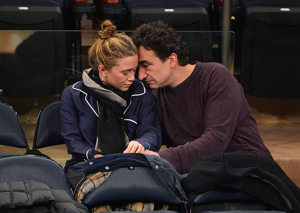 Mary-Kate Olsen and Olivier Sarkozy at a basketball game