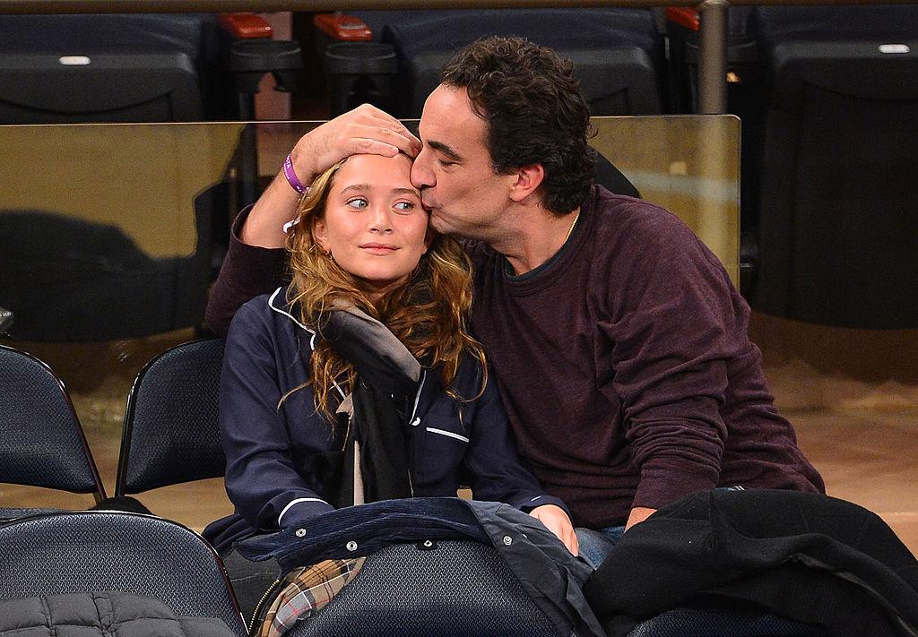 Mary-Kate Olsen and Olivier Sarkozy attend the Dallas Mavericks vs New York Knicks game at Madison Square Garden on November 9, 2012