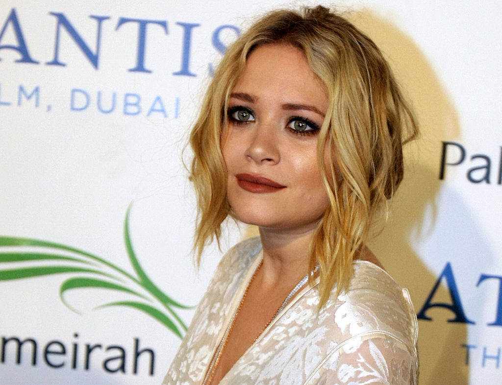 Mary-Kate Olsen poses for a picture at the official grand opening party for the Atlantis Hotel on the Palm Jumeirah in Dubai