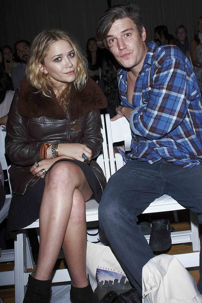 Mary-Kate Olsen and Nate Lowman attend the Benjamin Cho Spring 2009 fashion show