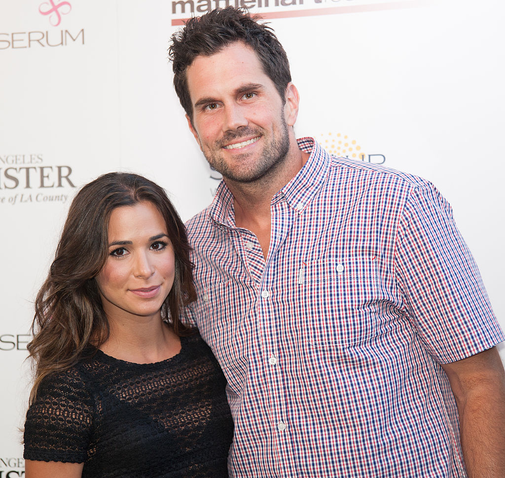 Matt Leinart and his wife Josie Loren posing at a charity event