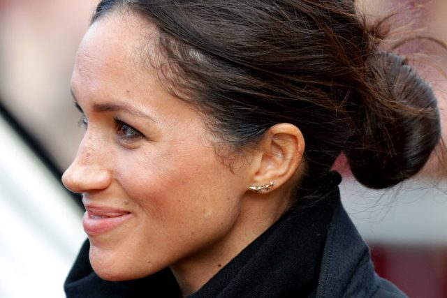 Meghan Markle with a messy bun hairstyle
