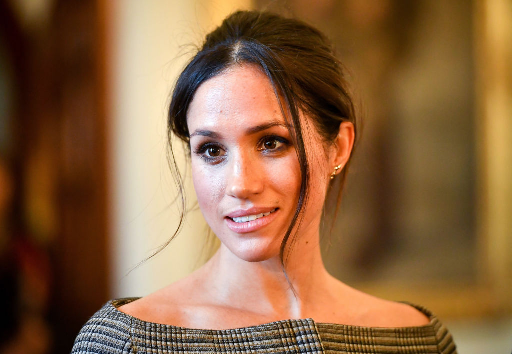Meghan Markle chats with people inside the Drawing Room during a visit to Cardiff Castle on January 18, 2018