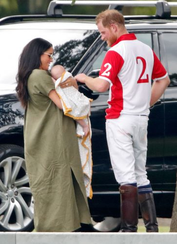 Meghan Markle holds Archie Harrison Mountbatten-Windsor, while standing next to Prince Harry
